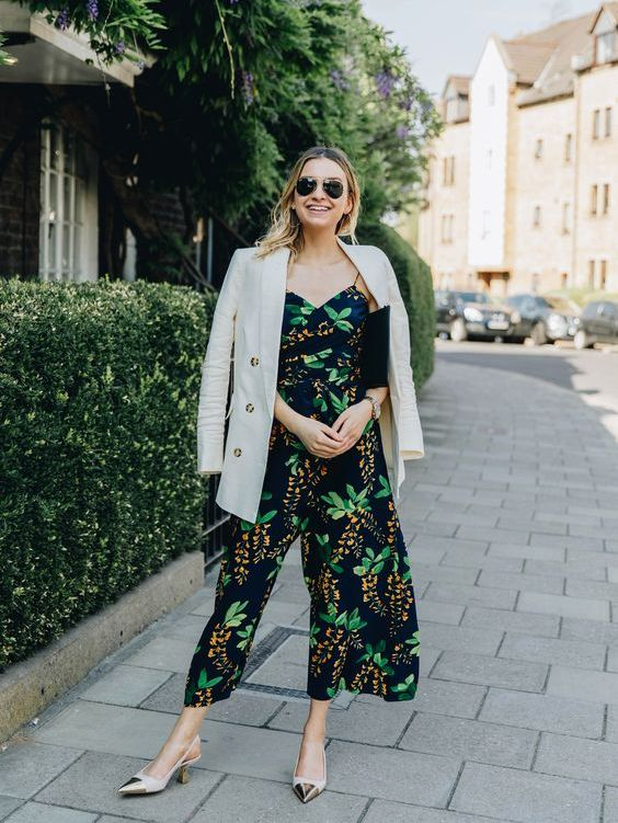 a moody botanical print jumpsuit with culottes, trendy slingbacks and a black clutch plus a neutral blazer