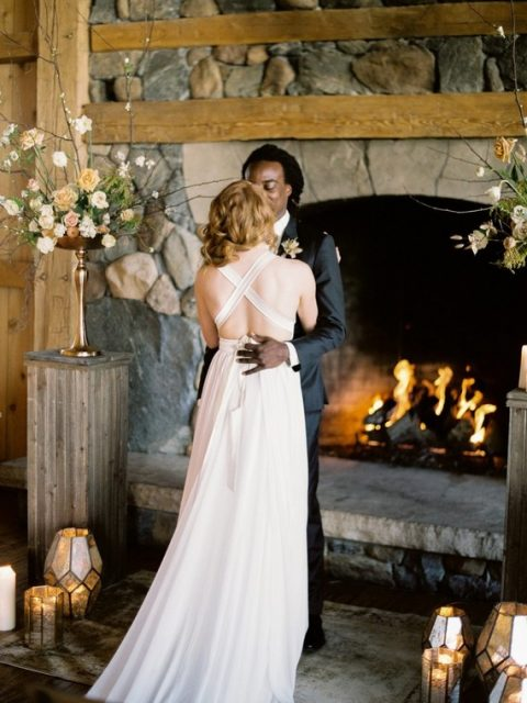 a romantic wedding dress with a criss cross back, a plain skirt and a train for a modern bride