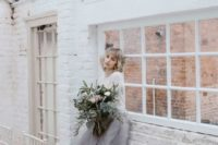 22 a modern bridal separate with a plain top and a grey layered skirt will fit a minimalist wedding