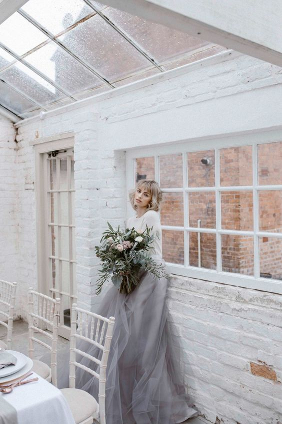 a modern bridal separate with a plain top and a grey layered skirt will fit a minimalist wedding