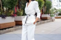 22 a modern white pantsuit with a deep neckline, a metallic belt and blush shoes to feel comfortable