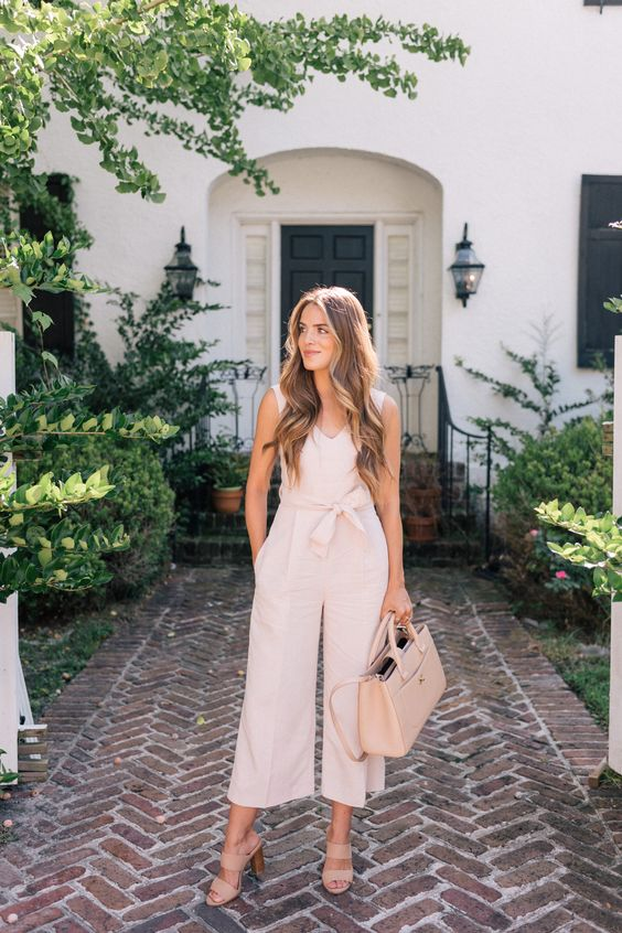 a neutral fitting jumpsuit with cropped wideleg pants, blush mules and a matching bag for a preppy casual look