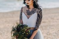 23 a non-traditional bridal look with a white spaghetti strap top and a grey layered tulle skirt plus a crystal crown
