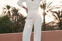 23 a simple plain white jumpsuit with a deep V-neckline and long sleeves is all you need for a casual wedding