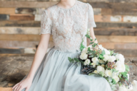 24 a romantic and chic bridal separate of a dove grey lace crop top with a high neckline and a plain layered skirt