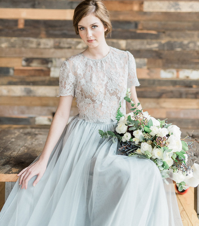 a romantic and chic bridal separate of a dove grey lace crop top with a high neckline and a plain layered skirt