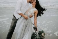 25 a sexy and romantic bridal separate of a white lace sleeveless top and a grey layered skirt with a train for a coastal bride