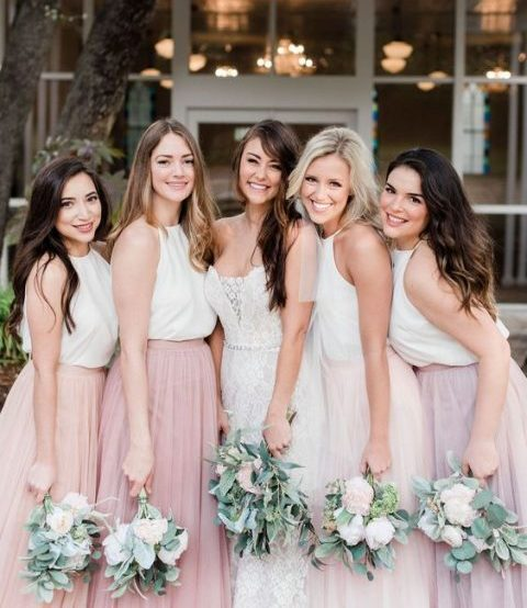 white halter neckline tops and mismatching blush, light pink and lilac maxi skirts for a summer wedding