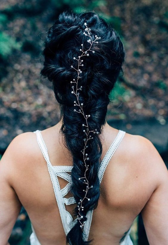 a twisted braid with a crystal hair piece is a unique and creative idea
