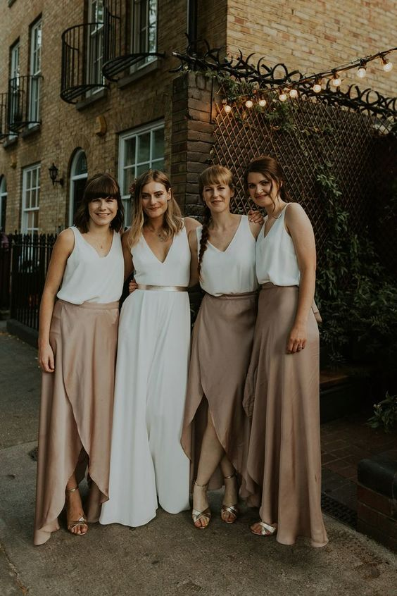 white wide strap tops and nude asymmetrical maxi skirts plus metallic shoes for a casual wedding
