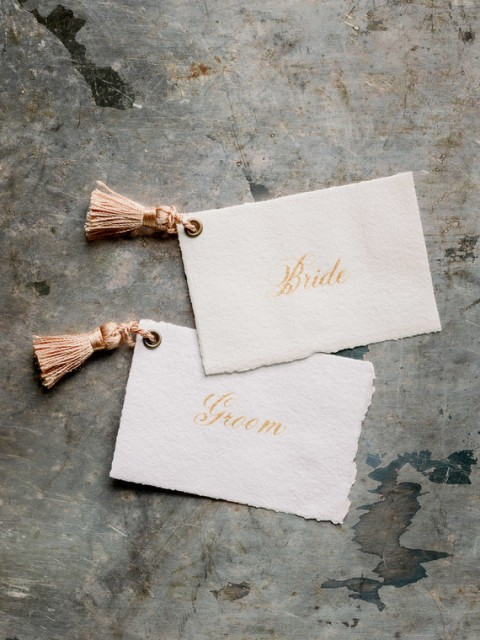 Cards with tassels is a very whimsy and cool wedding idea