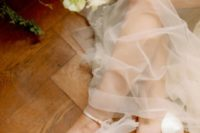 No doubt you will fall in love with these bridal tulle bow high heels