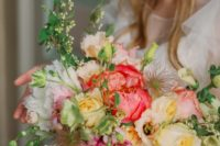 The bridal bouquet consisted of English garden roses, ranunculus and greenery