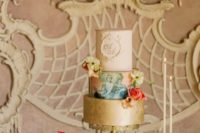 This wedding three tiered cake with flowers was absolutely beautiful