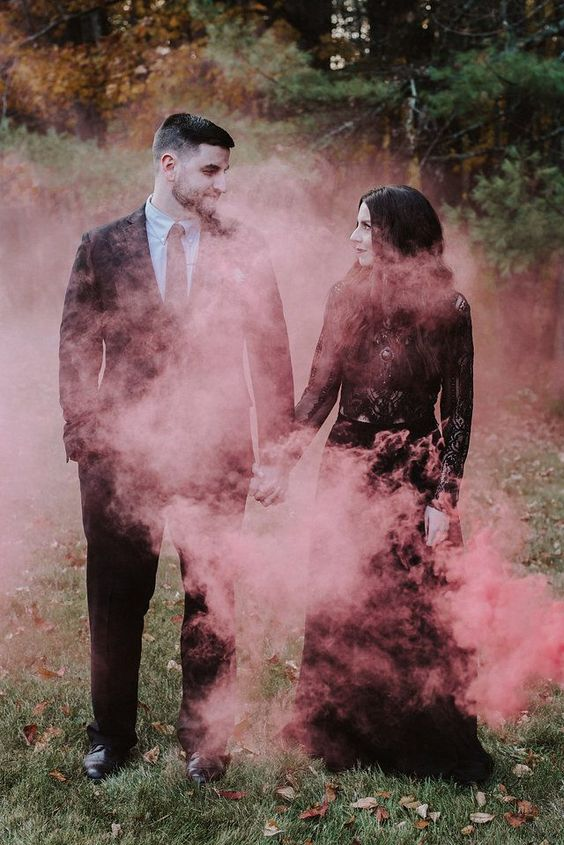 a gorgeous Halloween wedding photo done with red smoke is just jaw-dropping