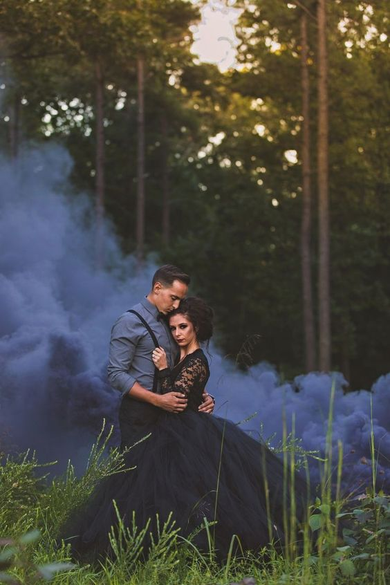 accent the moody theme and look of your wedding with appropriate smoke bombs, here graphite grey ones