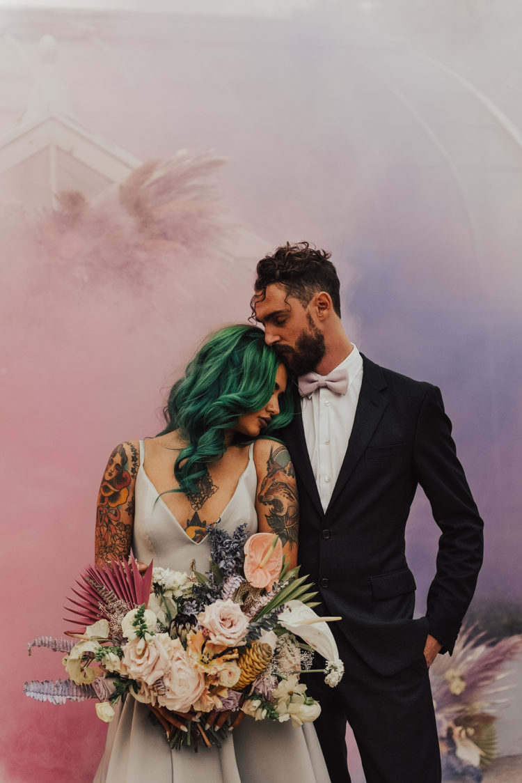 bring a romantic pastel feel to the wedding portraits with blush and lavender smoke in the pic