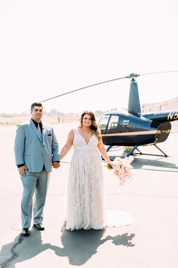 This couple went for an ultra modern wedding in black and blush and a grand entrance with a helicopter