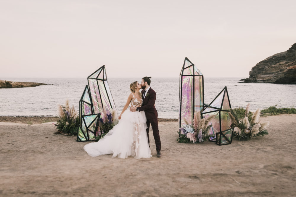 This unique beach wedding features iridiscent decor, everything unusual and personalized