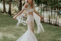 02 The bride was wearign a fantastic off the shoulder lace mermaid wedidng dress with fringe, a train and beading
