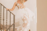 02 The bride was wearing a fantastic star peplum wedding dress with a long train