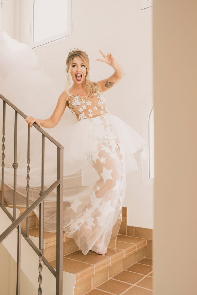 The bride was wearing a fantastic star peplum wedding dress with a long train