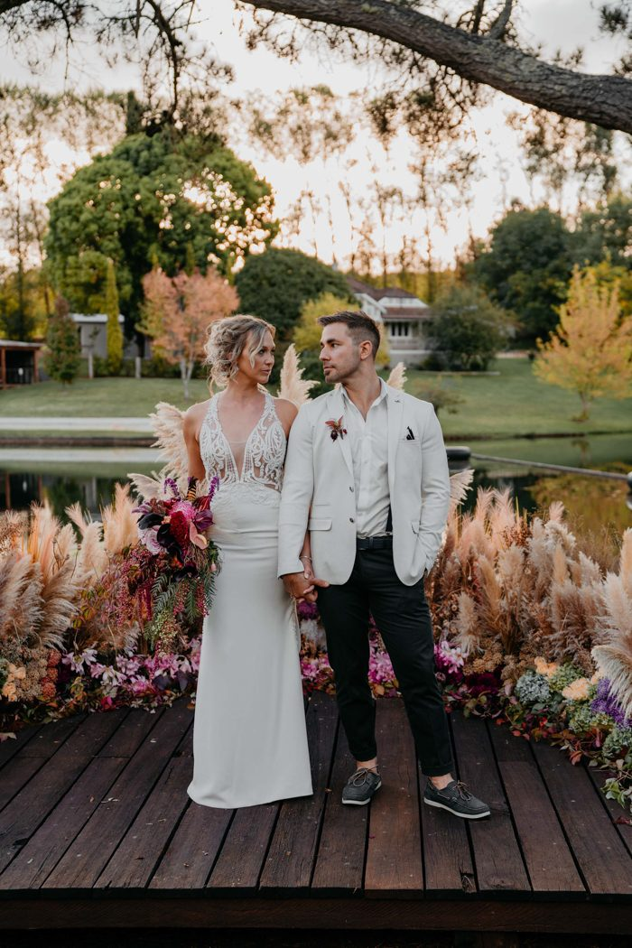 The bride was wearing a sheath plain wedding dress with a lace embellished bodice and the groom was rocking blakc pants and a white shirt and blazer