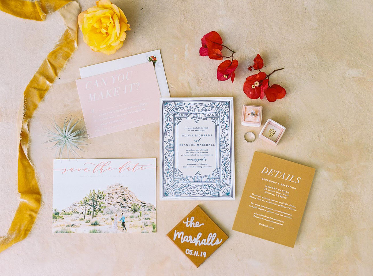 The wedding invitation suite was done in mustard, blues and blush, with pics of your wedding