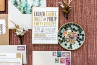 02 The wedding invitation suite was done with a hint on the place – forest-themed lining of the envelopes