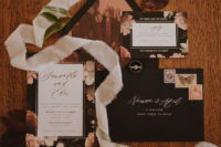 02 The wedding invitation suite was done with chic moody florals and blakc touches