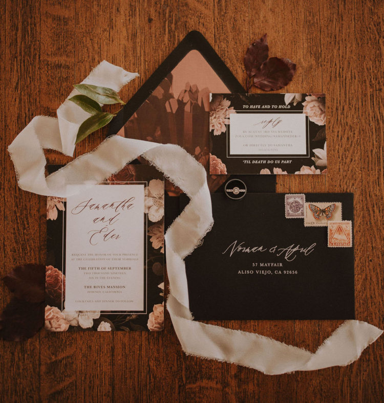 The wedding invitation suite was done with chic moody florals and blakc touches