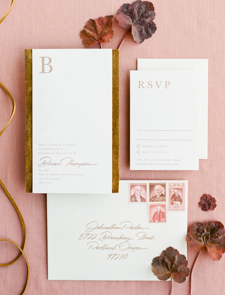 The wedding invitation suite was done with gold and rust touches plus calligraphy