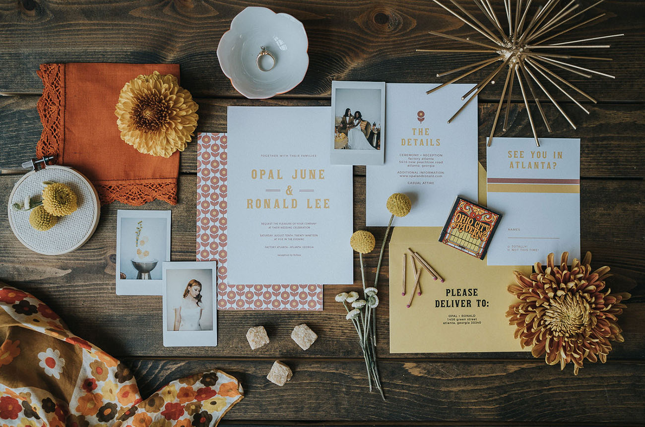 The wedding invitations were done in mustard and rust, with 70s prints