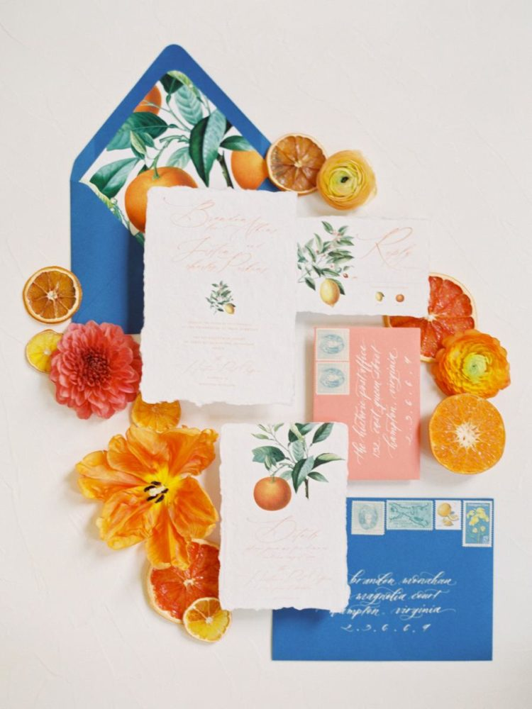 The wedding stationery was done in bright blue and coral pluus citrus prints