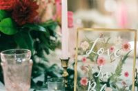 02 a beautiful wedding sign with pressed pink blooms and greenery is a cool wedding table decor idea
