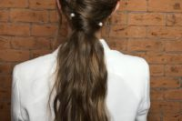 02 a casual twisted ponytail with waves is accented with pearl pins and made very chic and elegant