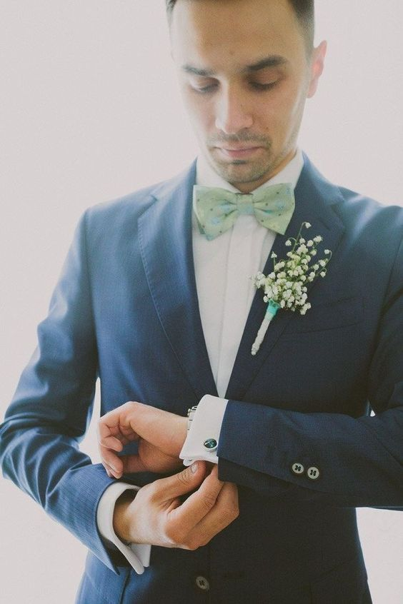 a trendy groom's look in a navy suit