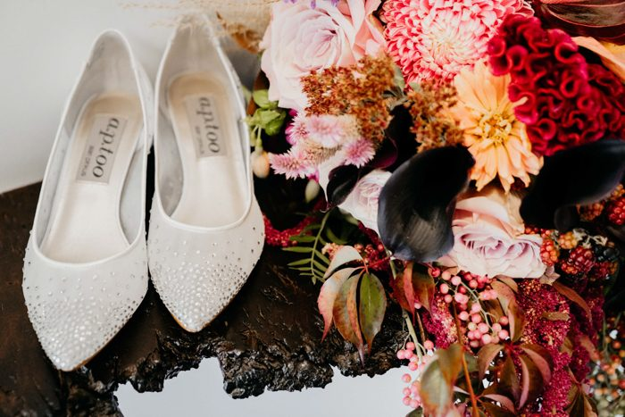 She was wearing elegant white shoes with embellishments