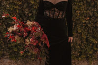 03 The bride was wearing a black velvet wedding dress with an illusion neckline and a lace insert, statement earrings and a chic updo