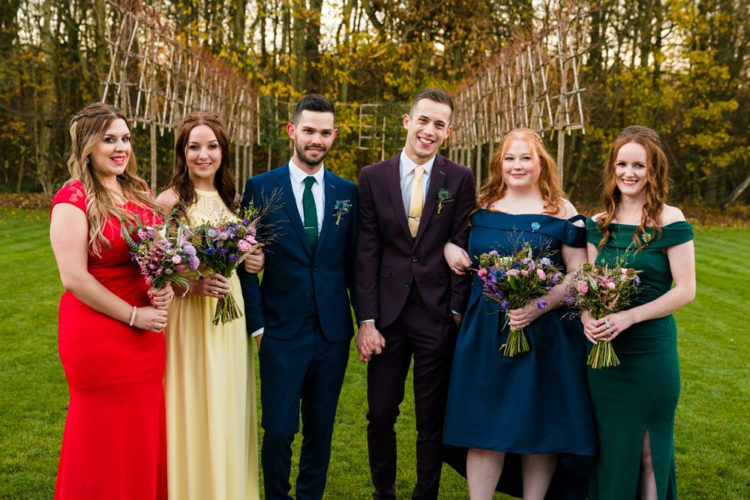 The bridesmaids were rocking mismatched dressed in autumn colors and jewel tones