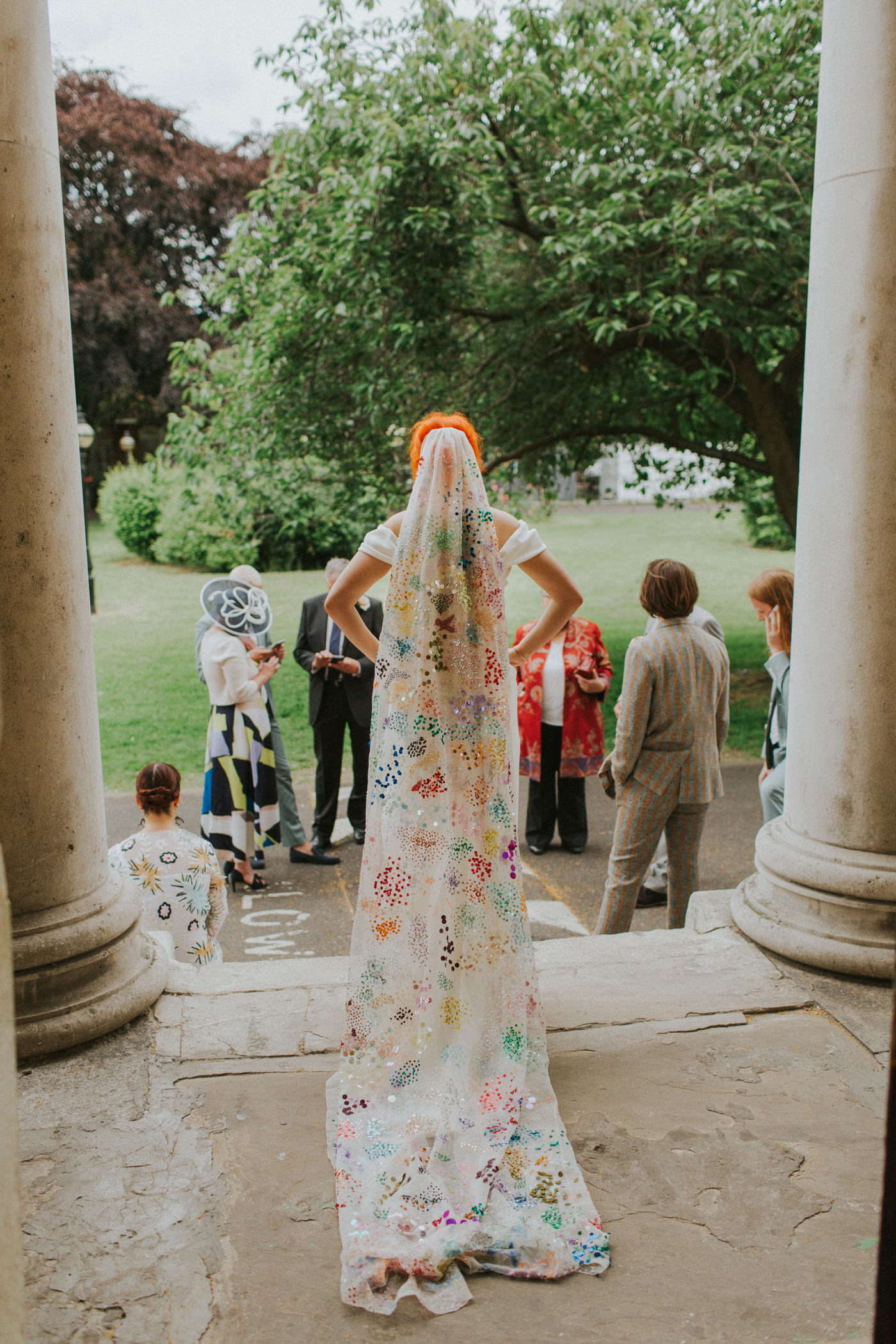 The gorgeous veil was colorful, embroidered and sequined