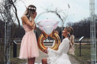 03 a glam proposal in pink, with candles, crystals and a playful balloon ring is a very cute and fun idea
