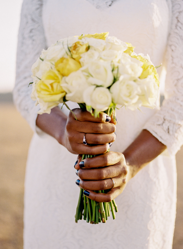Her bouquet was simple and was made of white and yellow roses