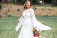 04 The bride was wearing an A-line wedding dress with bell sleeves and a cutout back