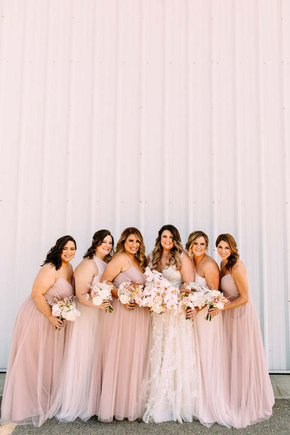 The bridesmaids were rocking mismatching blush maxi dresses