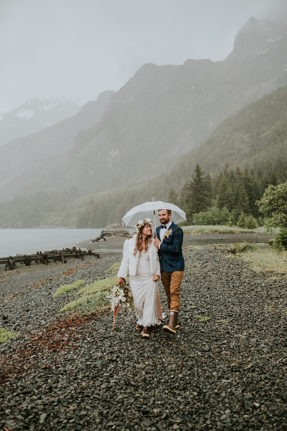 The groom was rocking mustard pants, a navy blazer, a bow tie and rubber boots