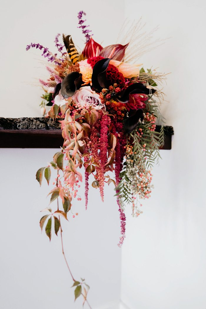 The wedding bouquet was super bright, in deep reds, deep purple, pink, greenery and berries