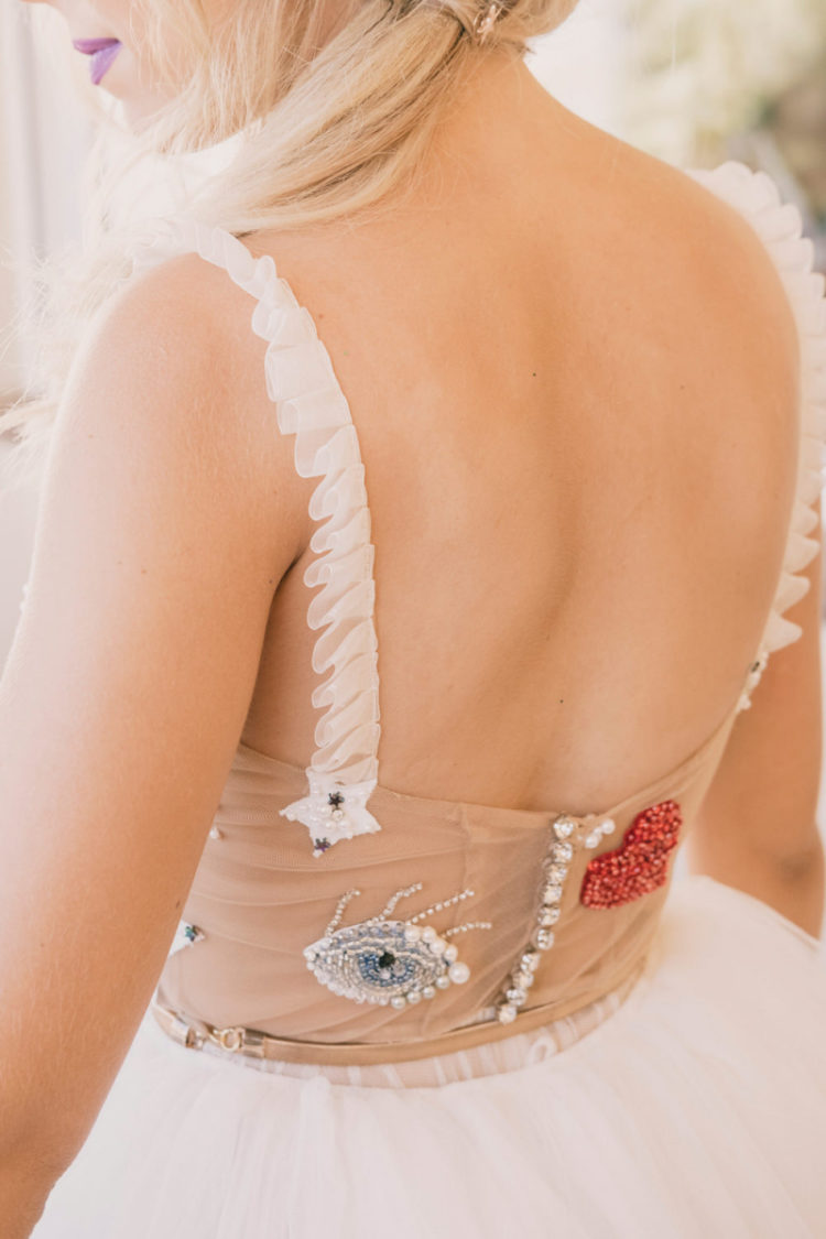 There are an embroidered eye and heart on the back of the dress that were created by a Spanish designer