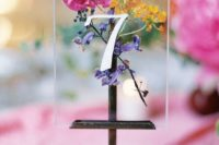 04 a bright wedding table number with bold blooms inside is ideal for a spring or summer boho wedding