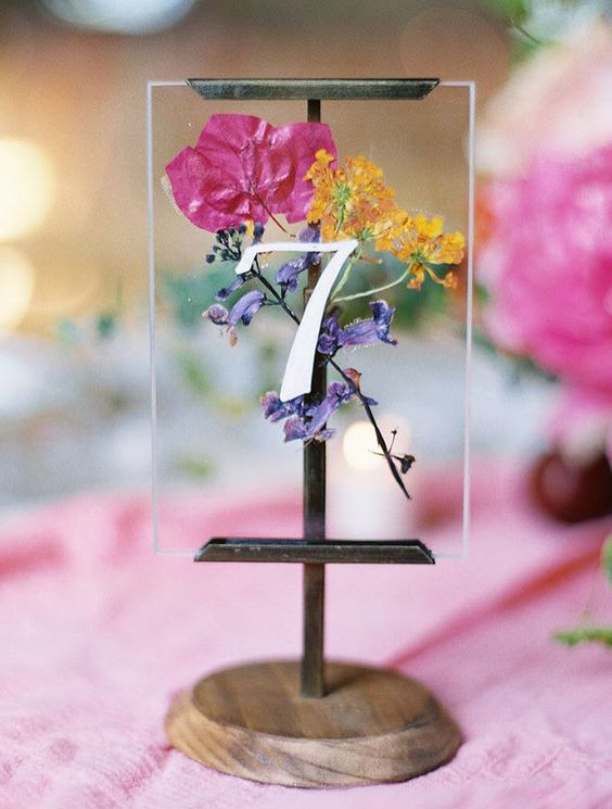 a bright wedding table number with bold blooms inside is ideal for a spring or summer boho wedding